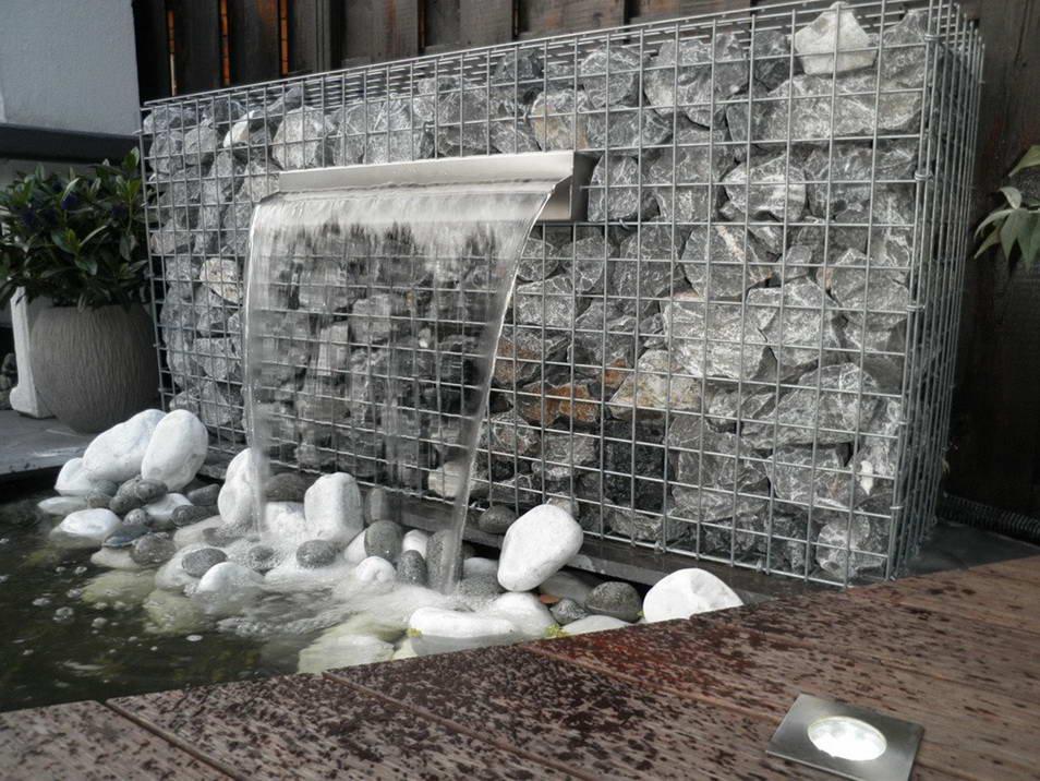 Разнообразие водопадов из камня с применением конструкций из габионов зависит только от вашей фантазии и площади сада.